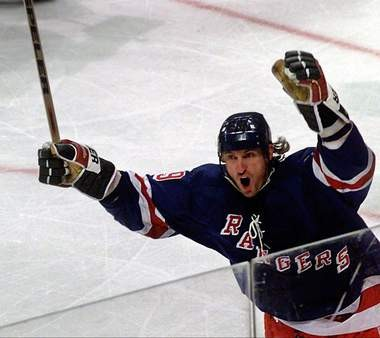 Wayne Gretzky, shown here after scoring during his final NHL season in 1997, makes Mark Eckel's NHL Mount Rushmore as well as his all-time, all-sports Rushmore.
