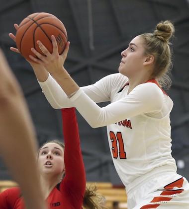 Princeton guard Bella Alarie takes a shot past Rutgers guard Kate Hill. (AP Photo/Mel Evans)