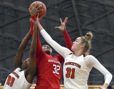 Rutgers center Desiree Keeling (32) tries to take a shot as Princeton forward Bella Alarie (31) and guard Sydney Jordan (20) defend. (AP Photo/Mel Evans)