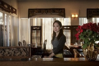 Owner Lisa Shao welcomes customers to the dining room of Szechuan House in Hamilton.