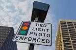 A red-light camera at an intersection in Newark. This and other cameras around the state will go dark on Dec. 16.