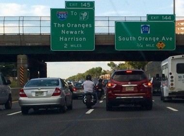 "Two motorcycles ""lane split"" in between traffic on the Garden State Parkway north."