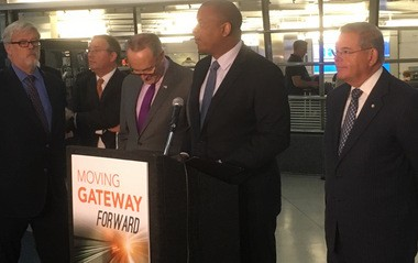 U.S. Transportation Secretary Anthony Foxx talks about progress made to fund construction of two new Hudson River rail tunnels and the rest of the Gateway Project at a press conference in Penn Station on Friday.
