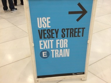 A sign at the World Trade Center transit hub tells commuters that they can't access the E train from the $4 billion structure.