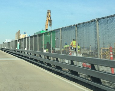 Crews working on the southbound lanes of the Pulaski Skyway to replace the bridge deck on Tuesday. While that would is 77 percent complete, a different project will push back the reopening date.