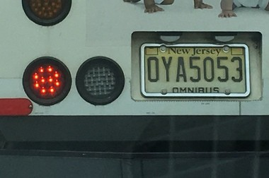 A license plate frame on an NJ Transit bus.