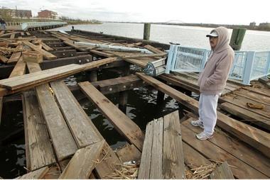 File photograph of Oscar Garcia of Elizabeth looking at the damaged boardwalk along Front Street in Elizabeth on Nov. 1, 2012, after Hurricane Sandy.