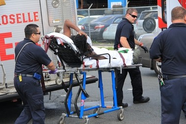 Roselle first responders transport one of the three men shot this afternoon near the corner of 12th Avenue and Warren Street. All three were in stable condition with minor injuries, a police spokesman said. Authorities were seeking two suspects.