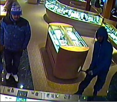 After the robbery, Cranford police released this security camera photo of two of three men who entered a township jewelry store and smashed a display case with hammers.