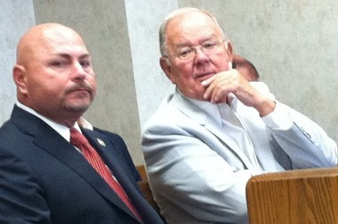 In this file photo, Michael Mathis, left, sits with former Union County Prosecutor Theodore Romankow, right, at an earlier court date related to Mathis' suit seeking to be reinstated as police chief.