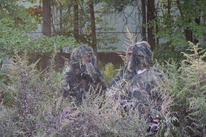 The Rahway Bushmen pose for a picture in Rahway River Park with their faces blurred.