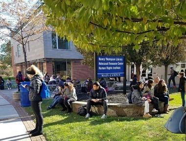 Students at Kean University wait outside to figure out why the power went out across the school.