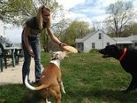 Christina Summit plays with Tucker and Mona after Tuckers surgery in May 2014.