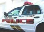 Hackettstown police charged a woman with a slew of offenses after she allegedly kicked a cop in the groin and spit on him.