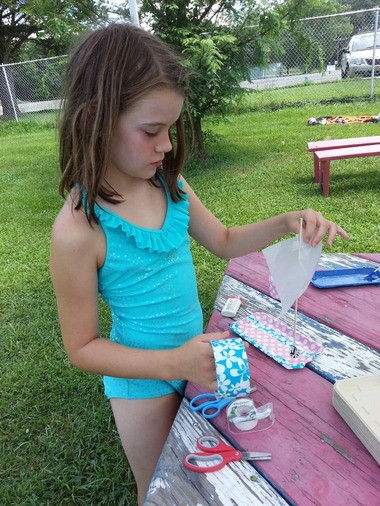 Caitlin Kosciolek making a sail boat.