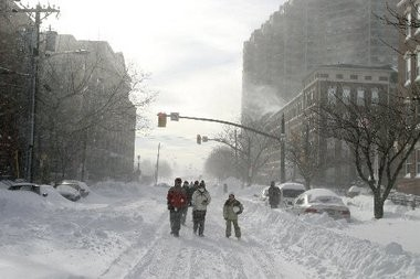 People walk the streets of Jersey City following a major snowstorm in December 2010.