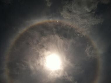 Ice crystals have caused a rainbow halo effect around the sun today.