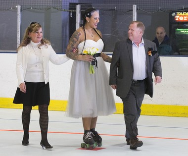 """Elizabeth and James Callahan escort their daughter, Suzanne Baucom, also known as """"Double Tuf Oreo"""" during her wedding ceremony at Inline Skating Club of America in North Arlington. (William Perlman   NJ Advance Media for NJ.com)"""