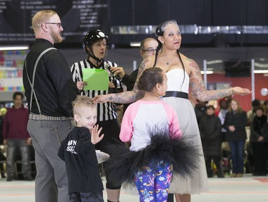 Suzanne Baucom and Brian Ross listen to officiant Nerissa Coan as their son Noah waves to family during their wedding at Inline Skating Club of America in North Arlington on Feb. 28. (William Perlman   NJ Advance Media for NJ.com)
