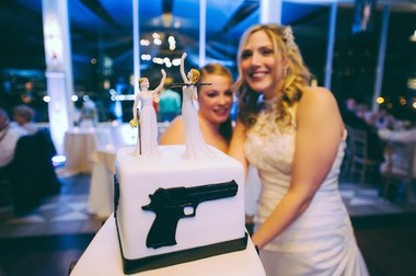The brides splurged on their wedding cake to make it more reflective of them both and the hobbies they enjoy. (George Koroneos/GLK Creative)