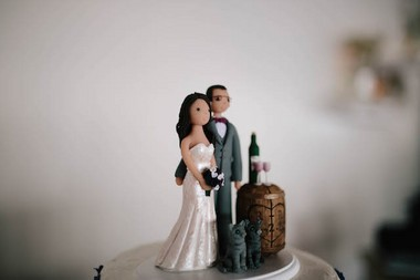 """""""I know it may sound silly, but our cake topper was also a bit of a splurge,"""" Rebecca Cohen said. (Allie Skylar Photography)"""