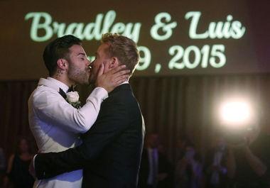 Luis Miller, left, and Bradley Moreland during the first dance at their wedding on June 20. (John Munson   NJ Advance Media for NJ.com)