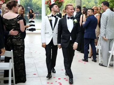 Luis Miller, left, blows a kiss to a wedding guest after marrying Bradley Moreland. (John Munson | NJ Advance Media for NJ.com)