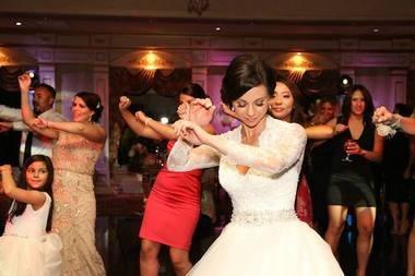 Adrienne Delli Santi dances with wedding guests on June 6 at Il Tulipano in Cedar Grove. (PoshDJs).