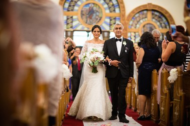 Leydi Hernandez walks down the aisle with her father, Humberto. (Asya Photography)