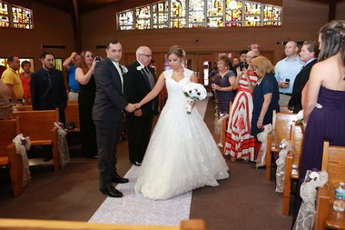 Christina McNulty's father, John, walks her to the altar to meet her groom, Gary Bifano. (Absolute Celebrations)