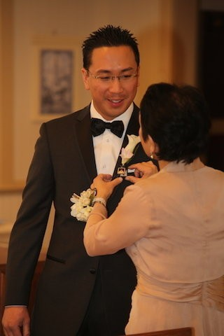 'My father passed away when I was young, so my wife had a photo charm made of my father to wear on my boutonniere and my mother presented it to me at the church,' Reuben Santos said. (Absolute Celebrations)