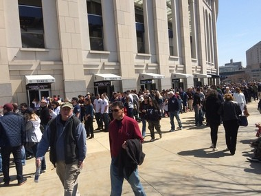 Lines of fans waiting to get past security wrapped around Yankee Stadium less than half an hour before first pitch. (Maria Guardado for NJ Advance Media)