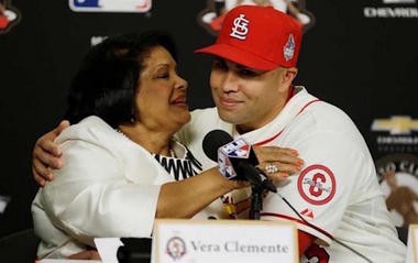 When Carlos Beltran was with the St. Louis Cardinals and won the Roberto Clemente Award in 2013, he got a hug from his hero's widow, Vera Clemente. (Jeff Roberson | AP)