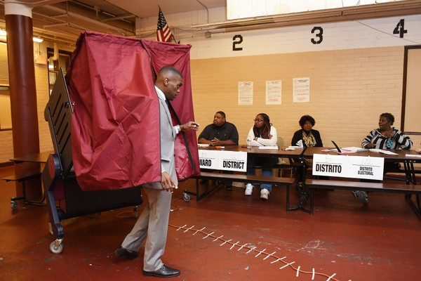 Democratic Assembly candidate for the 31st District, Bruce Alston exits the booth after casting his vote at Chaplain Charles Watters Elementary School in Jersey City in the primary election on Tuesday, June 2, 2015. Reena Rose Sibayan | The Jersey Journal