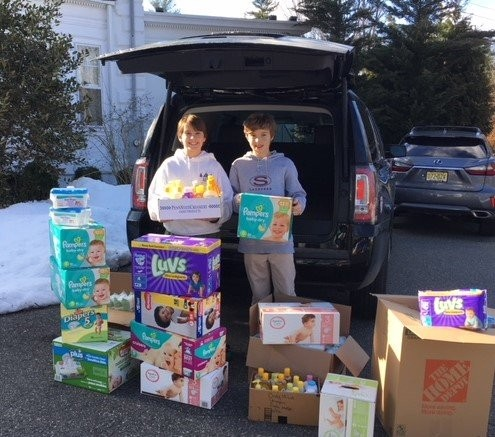 Charlie McGarity and Mason Ruschmeier recently dropped off a full carload of baby supplies to the Area Baby Center at Twin Maples. (courtesy photo)