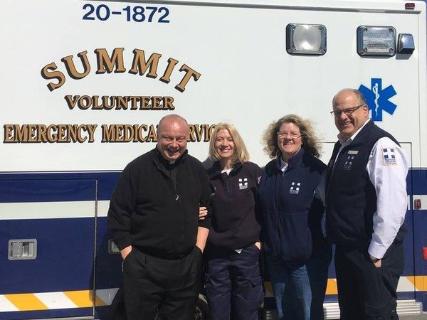 Pictured (from left) are Monsignor Robert Meyer, pastor of St. Teresa of Avila Church; and, Summit Volunteer First Aid Squad members Denise Barber, EMT; Beverly Brown, crew chief; and, John Buscaino, president. (courtesy photo)