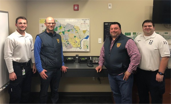 Pictured in the Summit Volunteer First Aid Squad's dispatch room are Summit EMS Equipment Lt. Anthony Campanelli, PAL President Charlie Robertson, Nick Curiale and Summit EMS Deputy Chief Matt Raymond. (Photo by John Staunton)