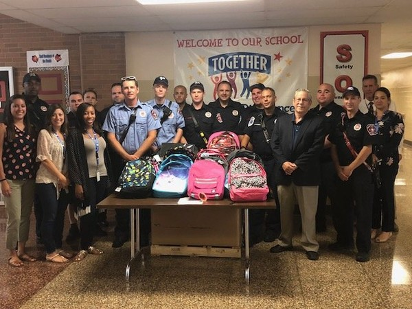 The career firefighters of Ewing's Station 30 recently donated over 100 backpacks, filled with school supplies, to students in the Ewing schools. (courtesy photo)