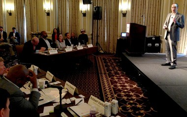 Scott Wolfe Jr. makes his pitch for the judges about his Zlien service for tracking construction liens at the Harrah's New Orleans Hotel during Entrepreneur Week 2013. Wolfe went on to be named co-winner of the contest, winning meetings and other access to investors.