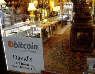 David's Antiques in the French Quarter has drawn attention with the sign on its door announcing that the shop accepts Bitcoin as a method of payment. Inside, co-owner Sharona Edry works behind a counter that displays Bitcoin souvenirs for sale.