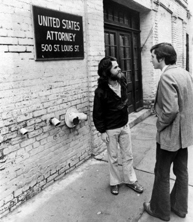 States-Item reporter Jim Amoss, right, accompanies a draft dodger as he heads for the U.S. attorney's office to seek amnesty, in December 1974.