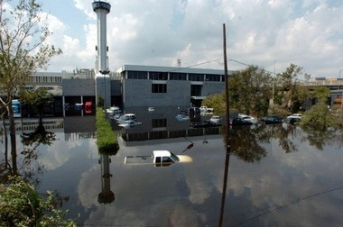 "The Times-Picayune staff evacuates post-Hurricane Katrina floodwaters outside its Howard Avenue facility in New Orleans in 2005: ""Such a pivotal moment for all of us,"" Amoss said."