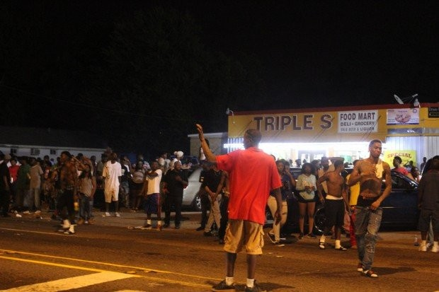People began gathering at the Triple S Food Mart where Alton Sterling was killed on Tuesday, July 5, the night after his death.