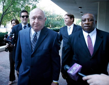 Former Jefferson Parish President Aaron Broussard, left, arrives at federal court in New Orleans with his attorney, Robert Jenkins, to plead guilty Sept. 25.