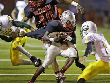West Jefferson's Niguel Veal maneuvers through Grace King defenders in the first half of their game at Hoss Memtsas Stadium on Thursday, October 3, 2013. (Photo by Chris Granger, Nola.com | The Times-Picayune)
