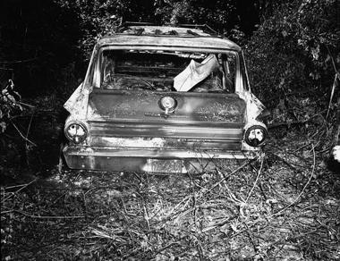 This June 1964 FBI photograph presented into evidence, Friday, June 17, 2005, in Philadelphia, Miss., during the trial of Edgar Ray Killen, who is charged with the 1964 deaths of three civil rights workers. The photograph shows the burned station wagon driven by James Chaney, Andrew Goodman and Mickey Schwerner was found shortly after their disappearance. The car was discovered at the Bogue Chitto swamp some 13 miles northeast of Philadelphia.
