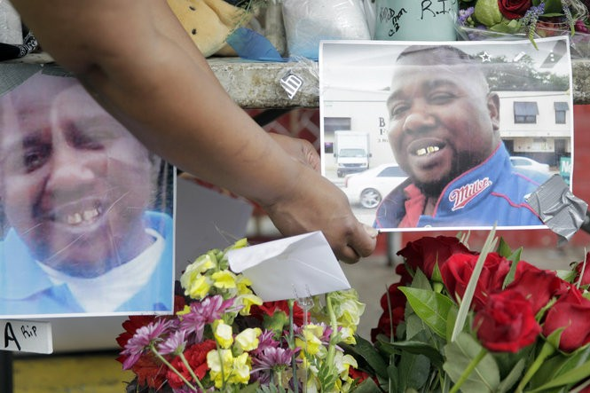 A memorial forms at the Triple S Food Mart to show support for Alton Sterling on Wednesday (July 6). (Photo by Brett Duke, NOLA.com | The Times-Picayune)