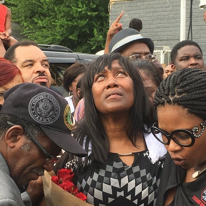 Sandra Sterling, Sterling's aunt who raised him, at a vigil Wednesday, July 6.