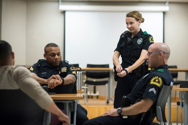 Left to right, Senior Cpl. Ruben Lozano, Sgt. Ivan Gunter, officer Gretchen Rocha and Senior Cpl. Ivan Saldana talk. (Photo for The Washington Post by Cooper Neill)