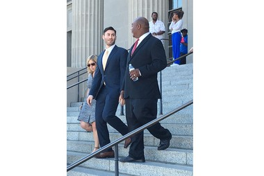 Dr. Peter Gold, center, speaks with prosecutor Kevin Guillory as they leave the New Orleans criminal courthouse Monday (Oct. 31) following the sentencing of Euric Cain. Cain, who pleaded guilty to attempting to murder Gold in November 2015, was sentenced to 54 years in prison.